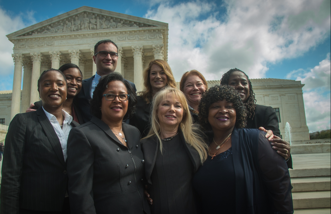 Christina Swarns stands in front of Supreme Court with her capital defense team