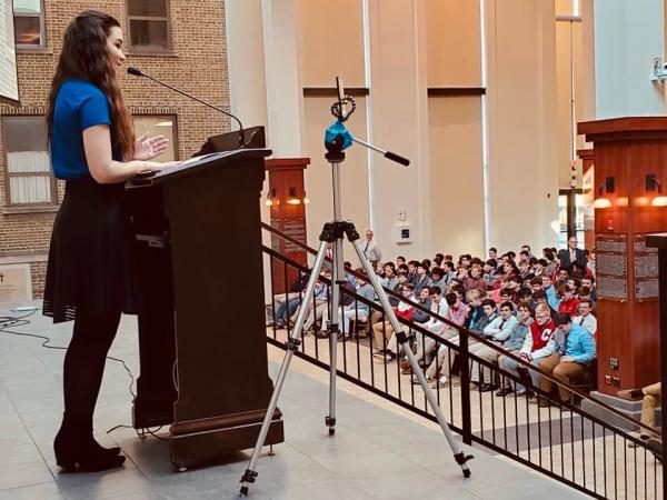 Emma Tacke speaks to Catholic high school students about the death penalty in Ohio