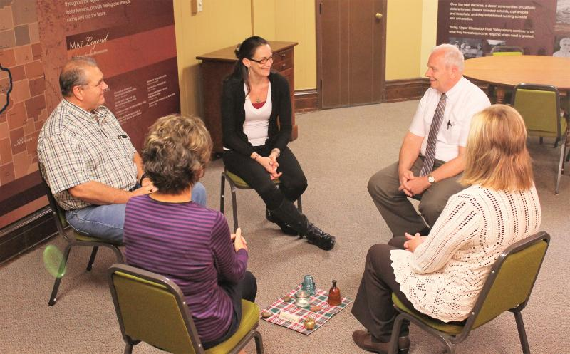 Deacon Tom Lang sits in a peacemaking circle
