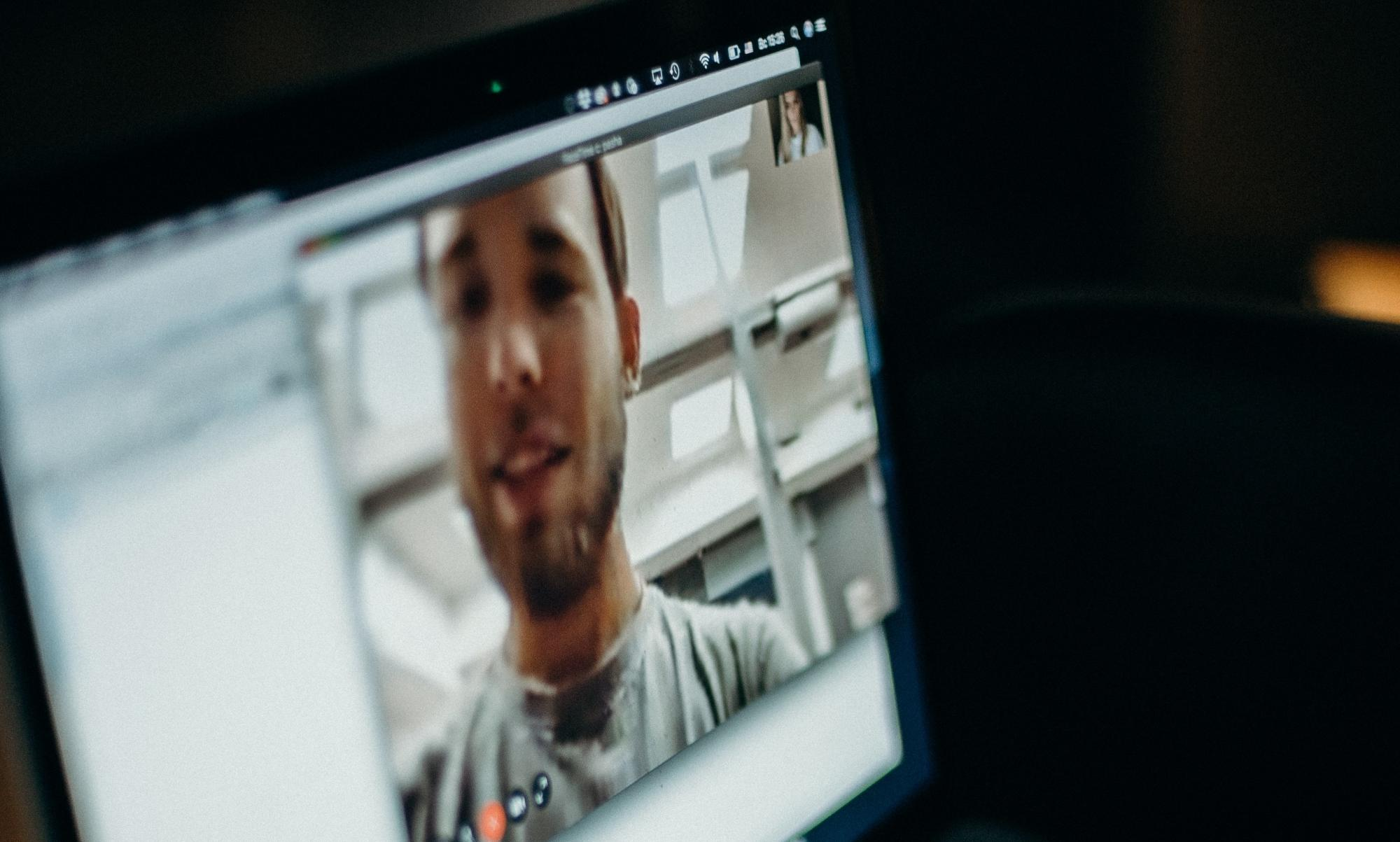 face on video chat screen, restorative justice