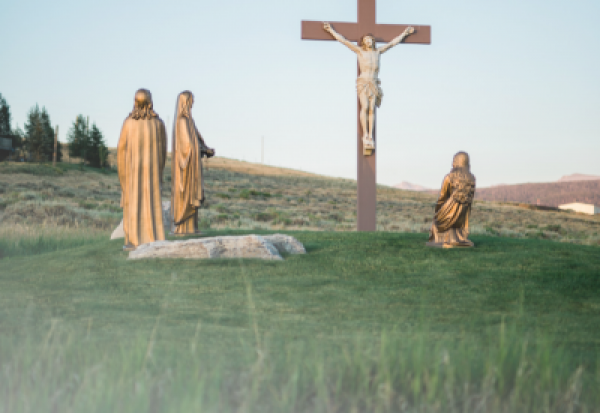 Cover of 2019 Lenten Reflections packet; image of a large crucifix in a field; text says 2019 Lenten Reflections