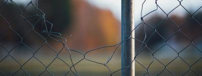 Wire fence with hole in it