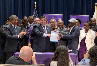 Illinois Governor J.B. Pritzker signs Senate Bill 64 into law.