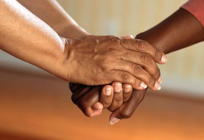Hands holding each other in support