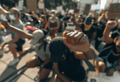 Protestors kneeling with fists raised