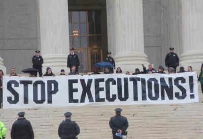 Demonstrators protest the death penalty on the steps of the U.S. Supreme Court