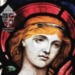 Stained glass image of angel holding dove